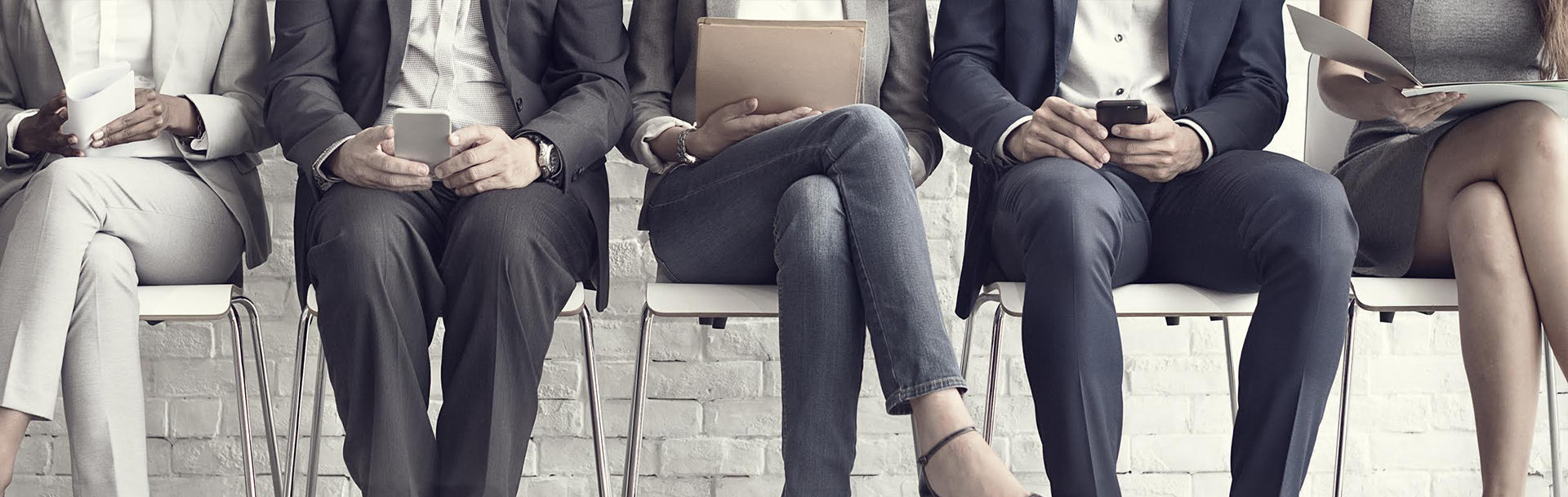Abstract image of business people sitting